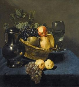 Still life with apples and grapes in a wicker basket, with a roemer and a ewer on a blue draped table by Judith Leyster
