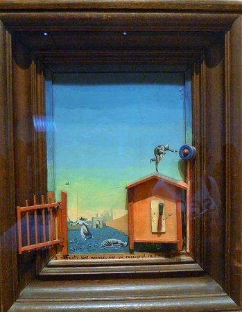 Two Children Are Threatened by a Nightingale by Max Ernst